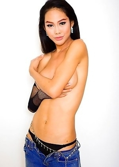 Wild Ladyboy Wawa totally topless in tight low rider jeans